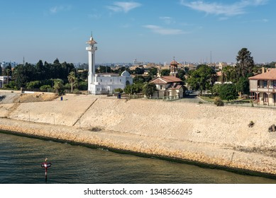 Ismailia, Egypt - November 5, 2017: El Shefaa Mosque and Ajat Church on the shore of Suez Canal in Ismailia City, Egypt, Africa.