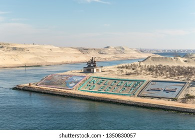 """Ismailia, Egypt - November 5, 2017: Suez canal authority monument and gigantic letters saying """"welcome to Egypt"""" in English and Arabic on a side of the New Suez canal, Ismailia, Egypt."""