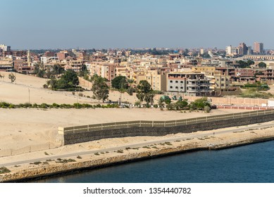 Ismailia, Egypt - November 5, 2017: Residential buildings on the shore of Suez Canal in suburb of Ismailia City, Egypt, Africa (Al Taawon).
