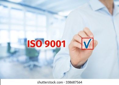 ISO 9001 - quality management system. Businessman select ISO 9001 certification. Wide banner composition with office in background.
