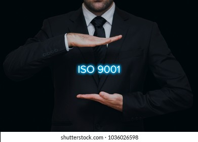 ISO 9001 standard for quality management of organizations with businessman in black background