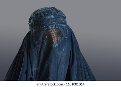 ISoalmic woman wearing closed bura over neutral background