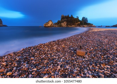 "Isola Bella (""Beautiful Island"") beach in Taormina, Sicily, at dusk."
