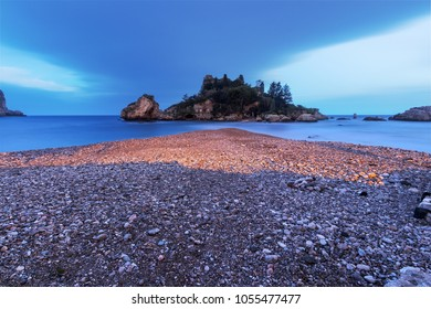 Isola Bella in Taormina (Sicily, Italy) seen at dusk. This is one of the most beautiful beaches in Sicily.