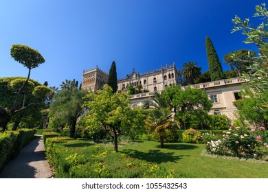Isola del Garda, Italy -  May 28, 2017: Venetian neogothic building of Villa Borghese Cavazza with garden