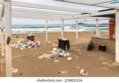 Isola delle Femmine, Sicily, Italy - September 18, 2018: Containers with garbage on the sand at the Isola delle Femmine in Sicily.