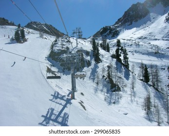 ISOLA, FRANCE - MARCH 26, 2012: Ski runs and a chair lift in ISOLA 2000, a French ski resort in the southern French Alps, located about 90 km from Nice, on a sunny day.