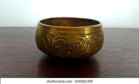 Isolate brass bowl and thai pattern.