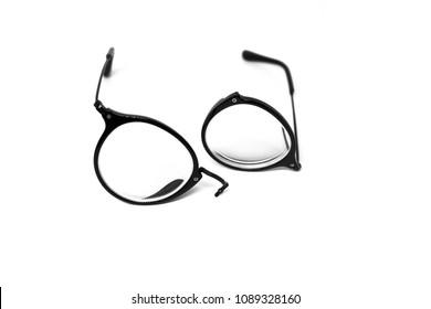 isolate broken eye glasses on white background, isolate broken black frame eye glasses on white background