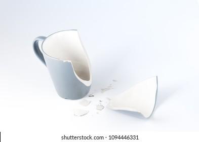 Isolate of a broken mug. Broken mugs and shards. Fron view.
