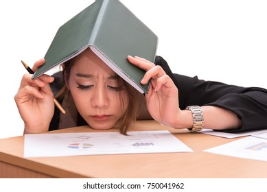 Isolate business woman are taking a book on their head to dodge the boss from the manager. Employee made sad face from stress of doing the wrong work.