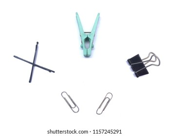 Isolate clips of different types. (paper clip, cloth clip, hair clip) on white background.
