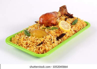 Isolated 3D view of chicken biryani on white background, traditional spicy indian food in fresh green plastic dish. Pakistani fried rice. Ramadan dinner or iftar meal or Diwali party.