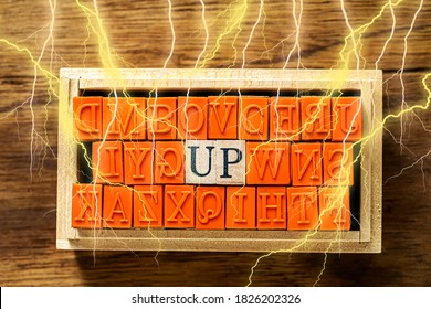 UP - isolated abstract in wood type stamps and lightning or thunder against wooden background and copy space.close up.