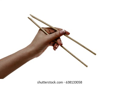 Isolated african female hand holds chopsticks on a white background.