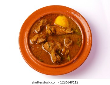 Isolated Alu gosht traditional indian dish, Famous pakistani food, Ramadan iftar meal, Diwali or christmas party dinner, Chicken Qorma for easter or birthday party on white background.