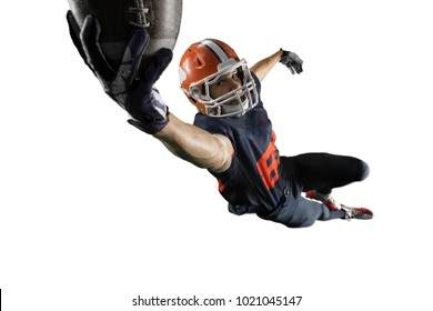 Isolated American football player jumps and catches the ball in flight in white background