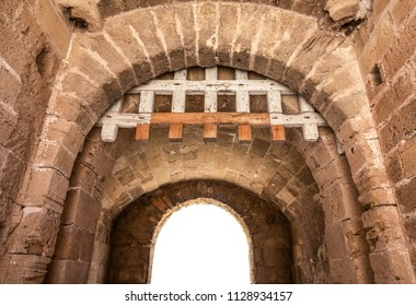 Isolated Ancient Medieval Fortress Archway With Wooden Portcullis