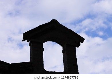 Isolated arch silhouette on the roof with cloudy sky background (Marche, Italy, Europe)