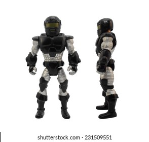 Isolated armored toy soldier in black futuristic suit standing.