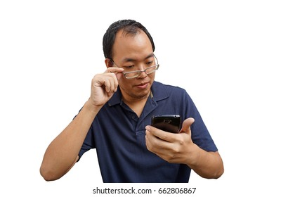 Isolated Asian glasses man with eye problem while using mobile phone