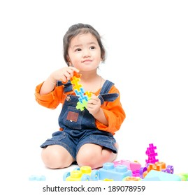 Isolated asian kid girl playing with toys , white background