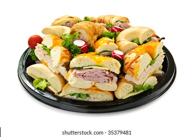 Isolated assorted platter of sandwiches with meat and vegetables