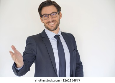 Isolated attractive businessman in suit extending arm out