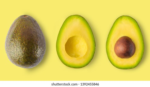 Isolated avocado on a yellow background. Whole avocado fruit and two halves in a row, isolated on a yellow background, in large size, Food concept