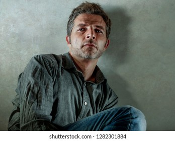 isolated background portrait of 30s to 40s sad and depressed man looking hurt  and worried suffering depression problem with dramatic face expression in sadness emotion concept