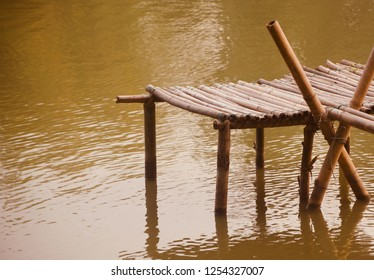 Isolated bamboo made structure on the lake water unique photo