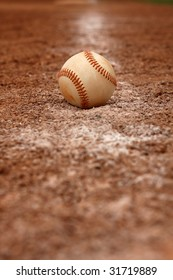 Isolated baseball on the faded chalk line