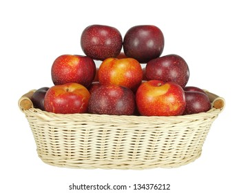 isolated basket of fresh and crunchy victorian plums