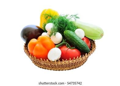 isolated basket of fresh vegetables and mushrooms