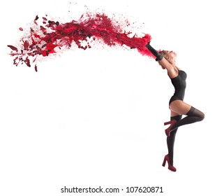 Isolated beautiful dancer with a wake of red paint coming out from her hands