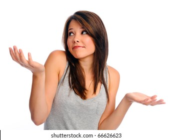 Isolated beautiful girl shrugs her shoulders
