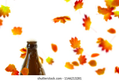 isolated beer bottle on fall leaf background