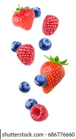 Isolated berries in the air. Falling strawberry, raspberry and blueberry fruits isolated on white background with clipping path