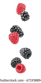 Isolated berries. Falling blackberry and raspberry fruits isolated on white background with clipping path