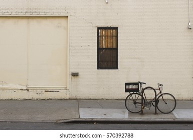 isolated bicycle locked up on new york city street