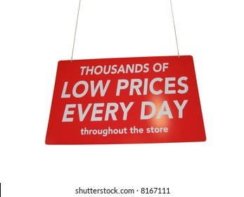 Isolated big, red and shiny retail sale shopping sign hanging from the ceiling of a store, with a spotlight shining on the word ?DAY?.