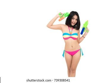 isolated bikini asia girl holding a water gun and happy playing.