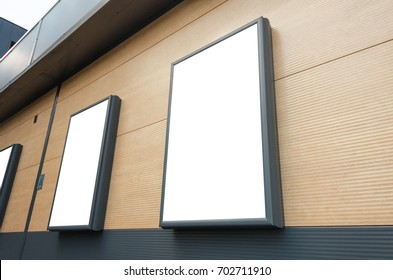 Isolated billboards at the shopping center wall. Mockup for marketing campaign promotion