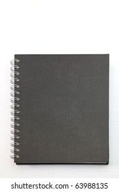 isolated black hard cover notebook with ring binder on white