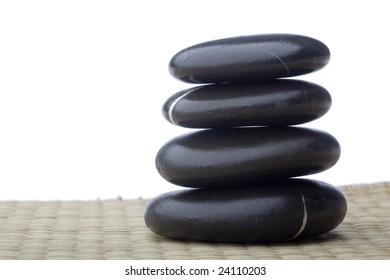 Isolated black massage spa stones