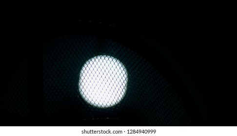 Isolated black nylon nets with white lights background photo
