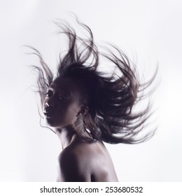 Isolated black woman portrait in the wind with long hair