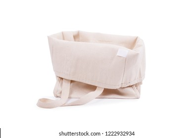 Isolated blank tote canvas bag on white background. An empty, light bag of eco-friendly natural materials is turned inside out. Mockup of product bag. Nothing inside.