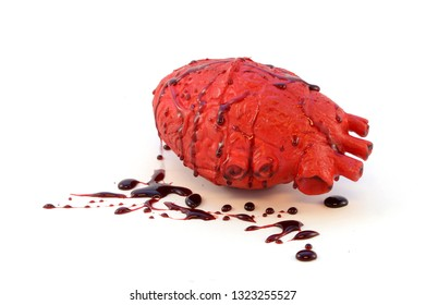An isolated bloody human heart over a white background.