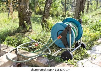 Isolated blue garden irrigator (Marche, Italy, Europe)